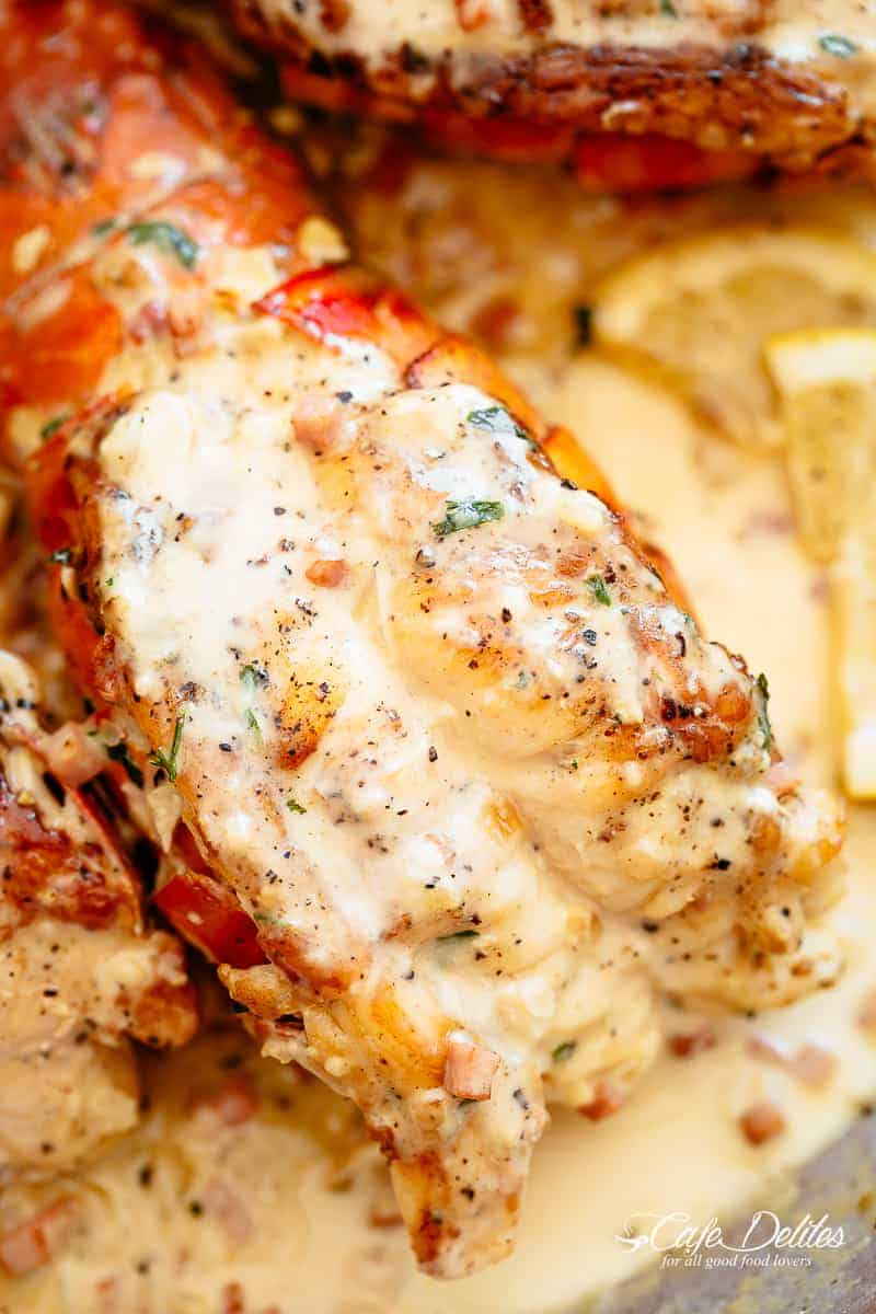 Close up of lobster tails with a cream sauce | cafedelites.com