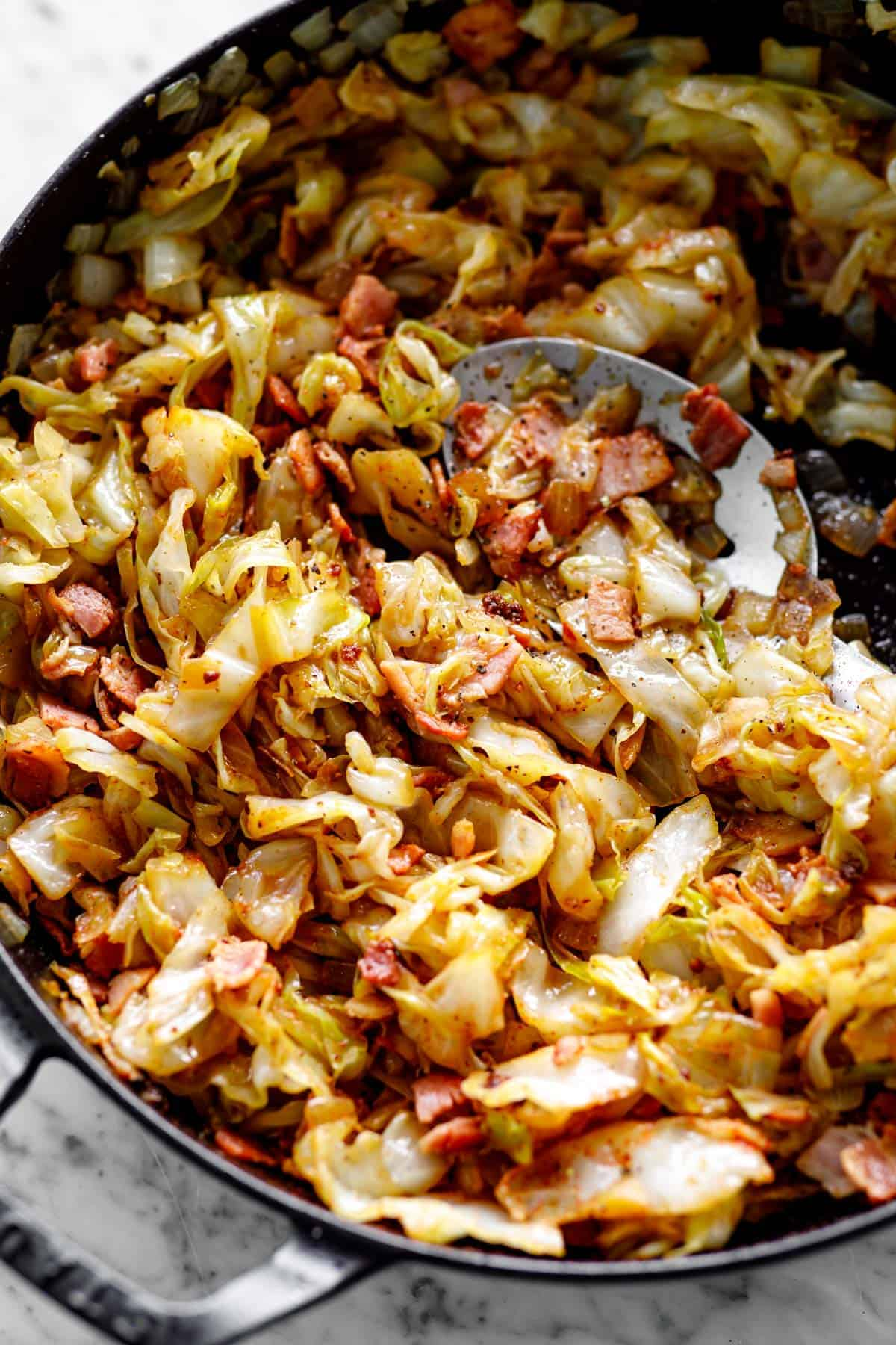 Fried Cabbage with bacon in a Staub cast-iron skillet | cafedelites.com