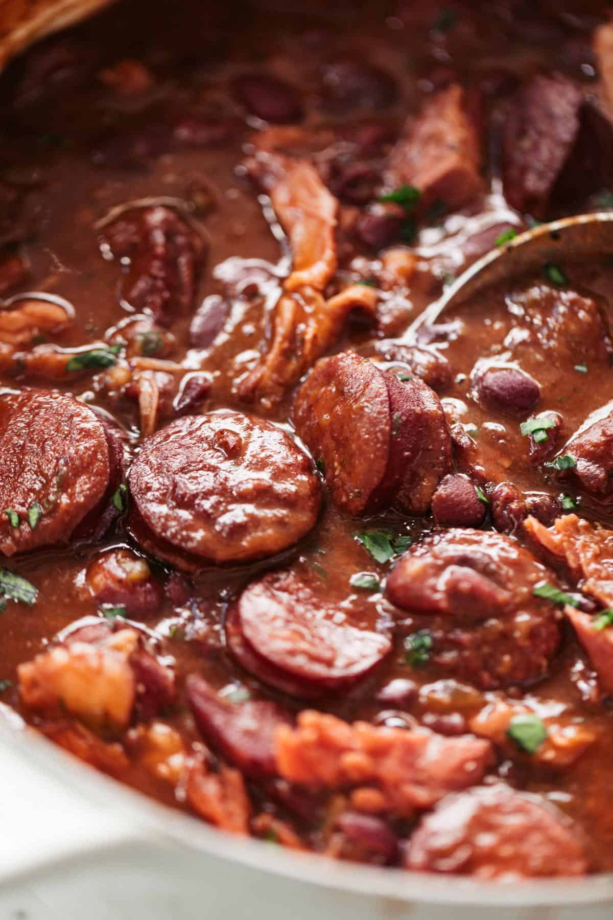A pot of red beans for rice with andouille sausage and ham shanks or ham hocks | cafedelites.com