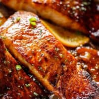 Crispy Honey Orange Glazed Salmon fillets are pan-fried in the most beautiful honey-orange-garlic sauce, with a splash of soy for added flavour! | cafedelites.com