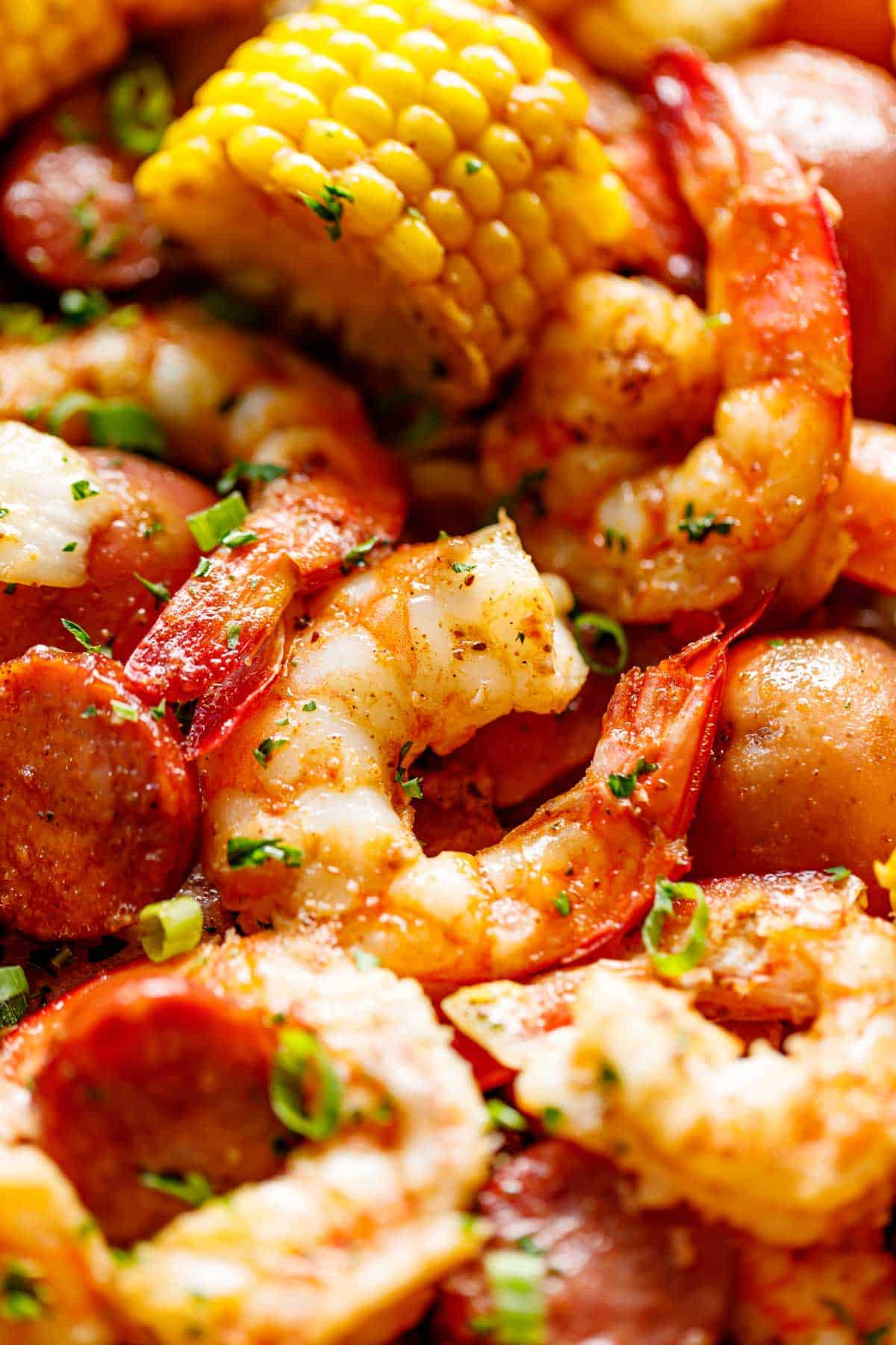 Shrimp Boil smothered in garlic butter and Old Bay seasoning made easy in the oven. Ready in 30 minutes! | cafedelites.com
