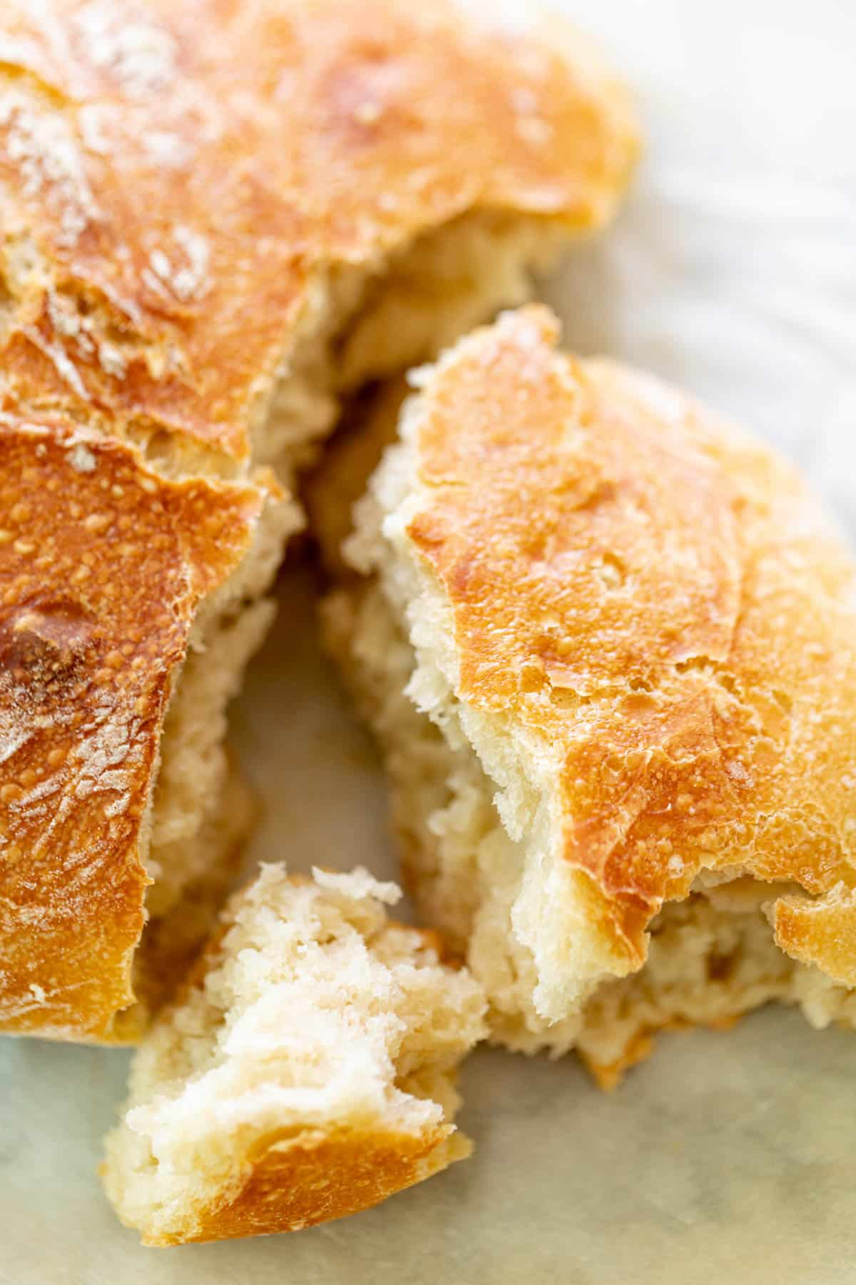 A torn piece of Artisan Bread | cafedelites.com