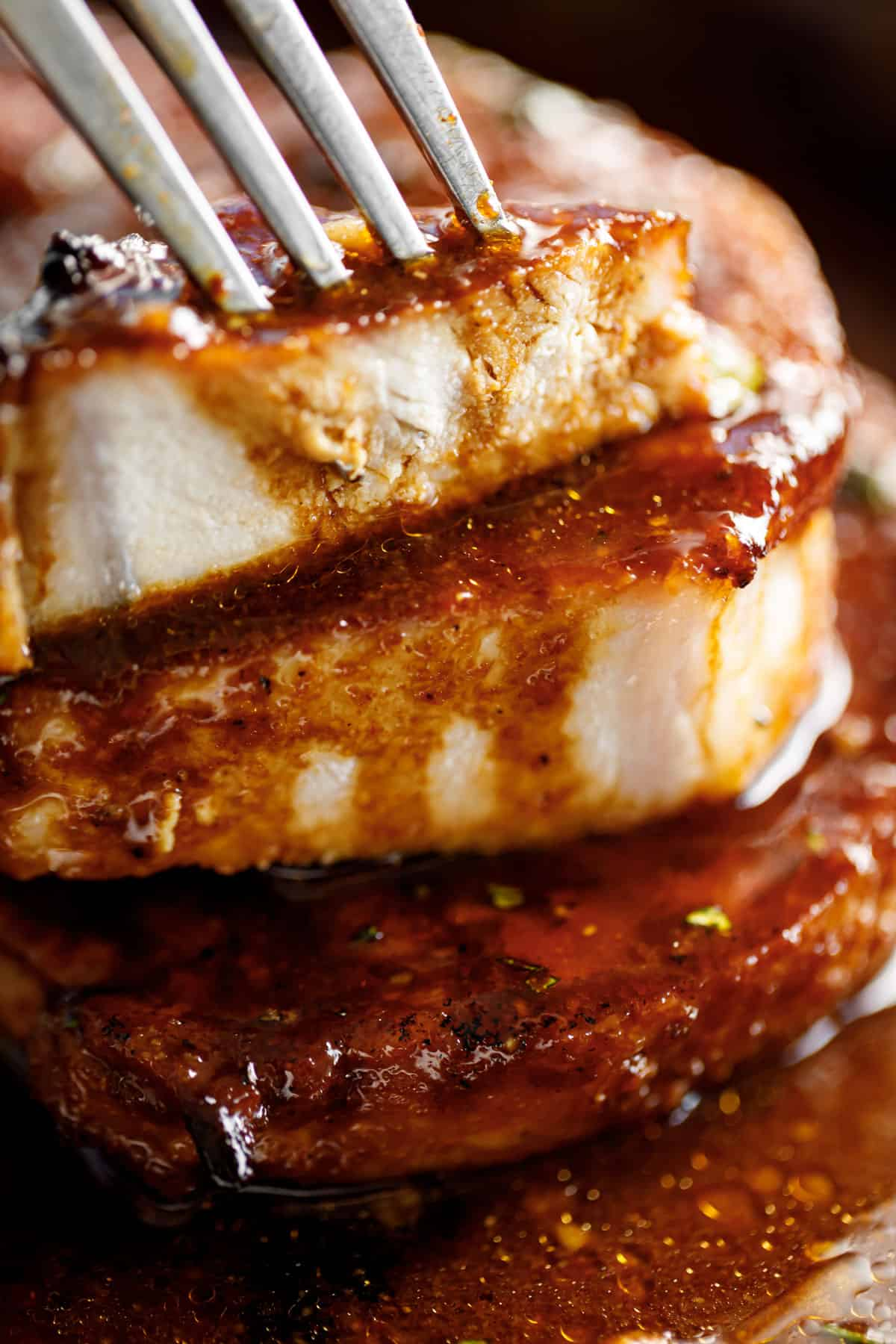 Juicy sliced pork chops drizzled with sauce | cafedelites.com