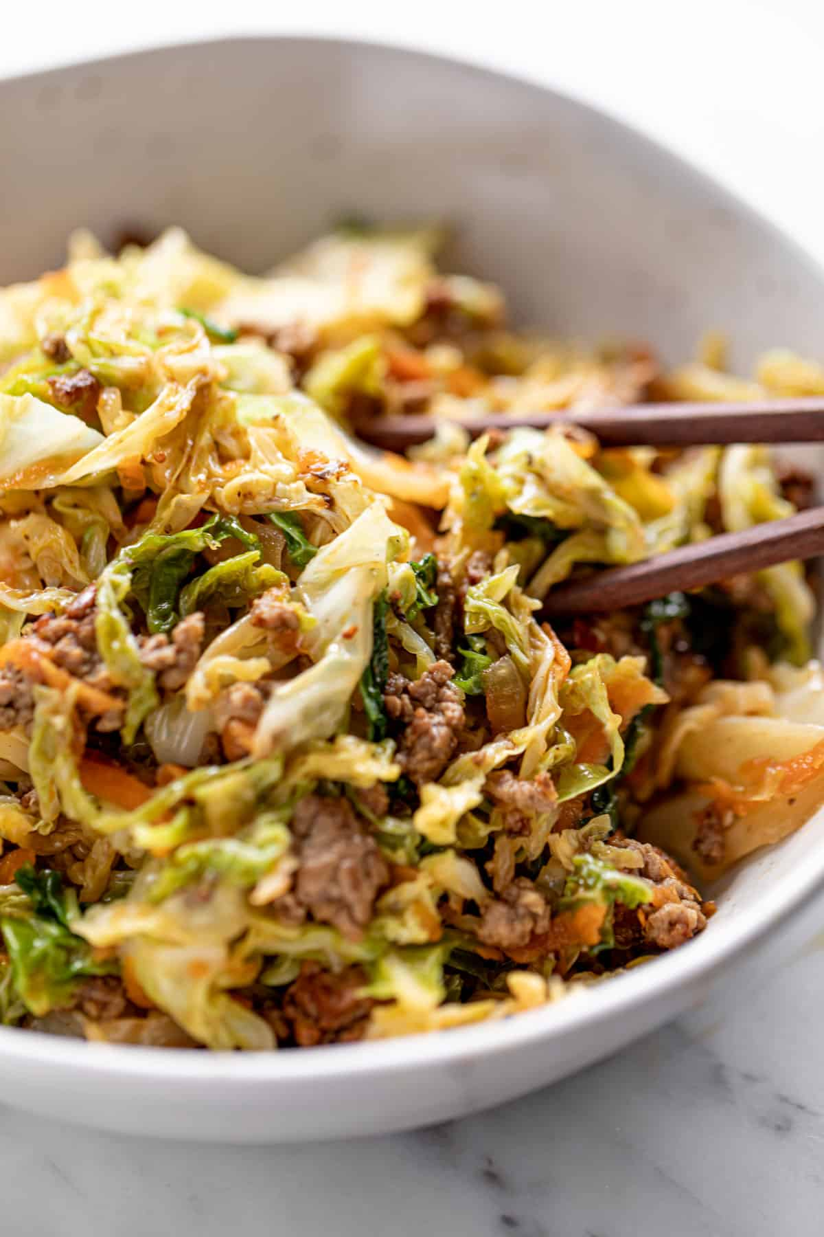 Ground Beef in a bowl with cabbage, served with chop sticks | familycuisine.net