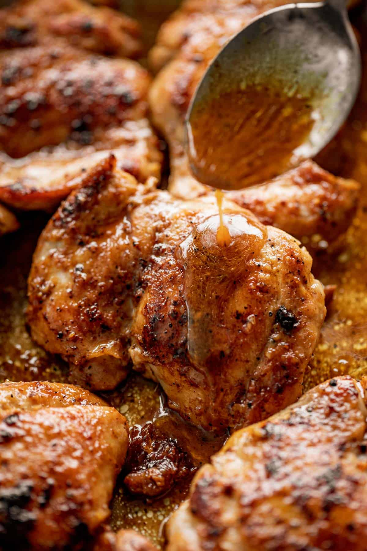Boneless chicken thighs drizzled with sauce