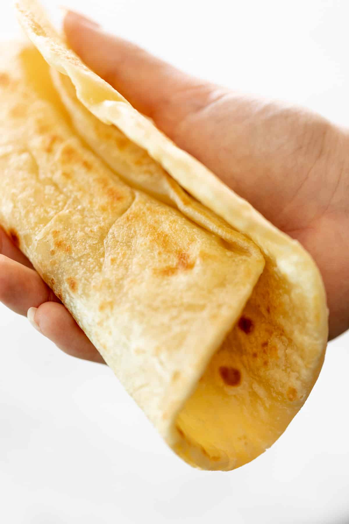 Holding a soft flatbread folded