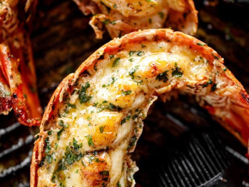 Grilled Lobster Tails with melted garlic herb butter on a black grill pan | cafedelites.com