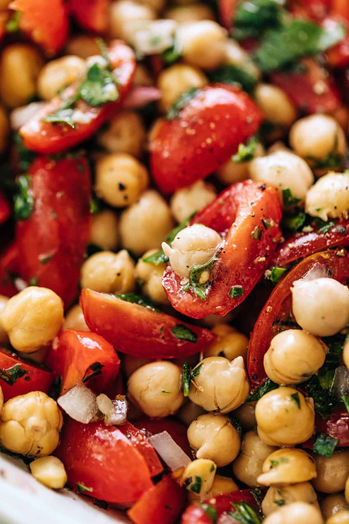 A close up image of a bowl of Chickpea Tomato Salad | cafedelites
