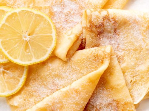 3 crepes with lemon slices and caster sugar | cafedelites.com