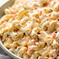 Macaroni Salad is quick to throw together and so DELICIOUS! A versatile, fool-proof pasta salad recipe with a full-flavored creamy dressing.