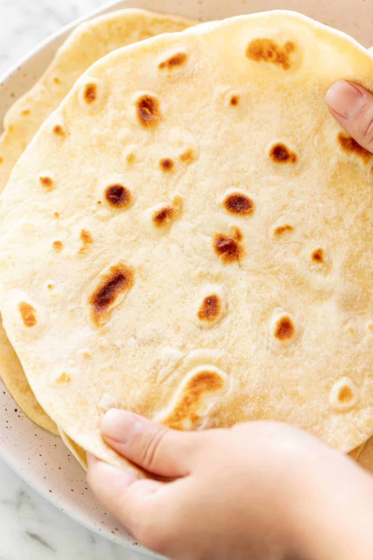 Holding a Flour Tortilla to show size | cafedelites.com