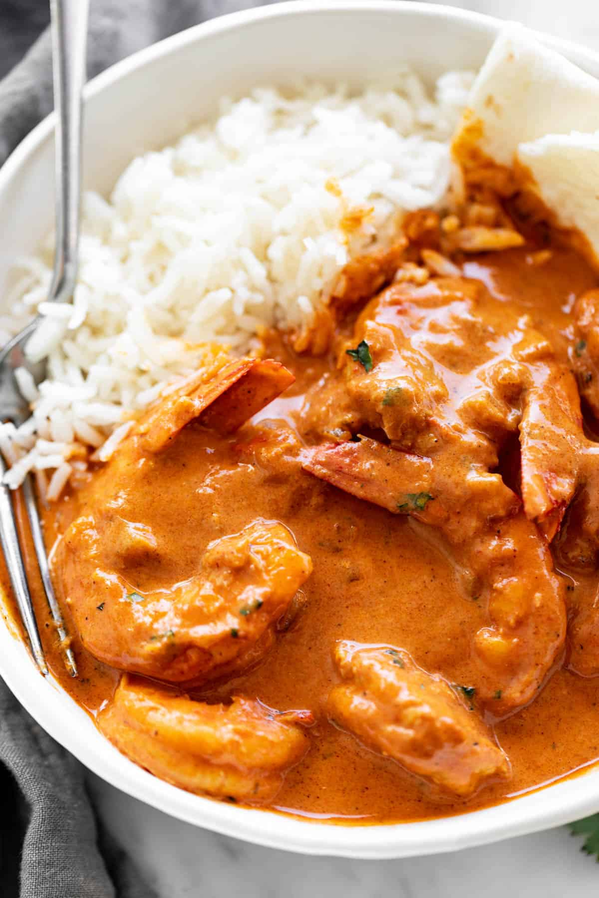 Shrimp curry served with rice and naan bread | cafedelites.com